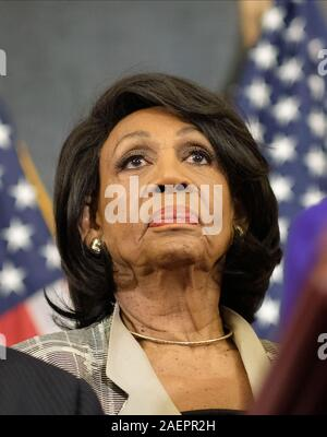 Washington DC, USA. 10th Dec, 2019. United States Representative Maxine Waters (Democrat of California), listens during a news conference laying out articles of impeachment for President Donald J. Trump, on Capitol Hill in Washington, DC on Tuesday, December 10, 2019. Credit: dpa picture alliance/Alamy Live News - Stock Photo