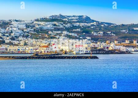 Mykonos, Greece famous island panorama with whitewashed houses, windmills, view from the sea in Cyclades