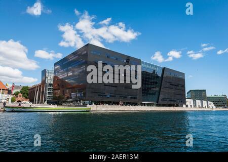 Black Diamond Copenhagen, waterfront view of the Den Sorte Diamant building, a modern extension to the Royal Danish Library in Slotsholmen, Copenhagen - Stock Photo