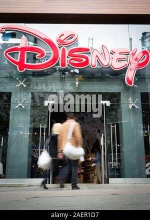 Disney Store, Oxford Street, London. Anonymous shoppers walking past the Disney store in the heart of London's shopping district. - Stock Photo