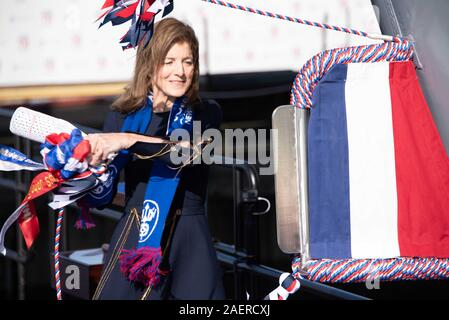Amb. Caroline Kennedy, daughter of the late President John F. Kennedy swings a bottle of champagne to christen the new Ford-class aircraft carrier USS John F. Kennedy at Huntington Ingalls Industries December 7, 2019 in Newport News, Virginia. Kennedy is the second ship in the next-generation Ford-class of nuclear-powered aircraft carriers and the second U.S. aircraft carrier named for President Kennedy, with the former retired from service in 2007. - Stock Photo
