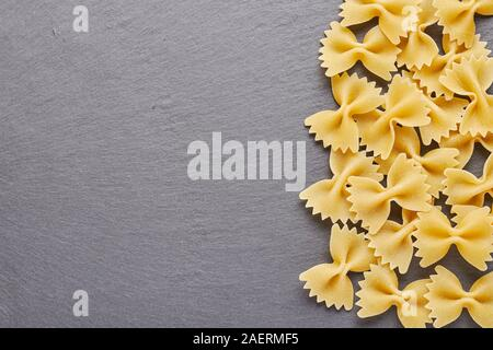 Food ingredients for cooking pasta on the background of black slate with plenty of free space for your project. - Stock Photo