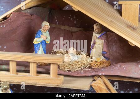 Nativity scene with provencal Christmas crib figures in terracotta - Stock Photo