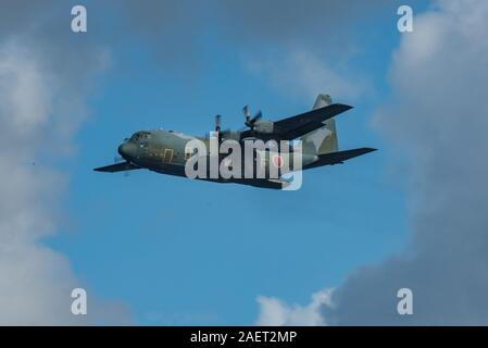 A C-130H Hercules assigned to the Japanese Air Self-Defense Force drops a Low-Cost, Low-Altitude bundle as part of Operation Christmas Drop 2019 at Andersen Air Force Base, Guam, Dec. 8, 2019. OCD is a quadrilateral training mission designed to give C-130 crews from the U.S. Air Force, Japanese Air Self-Defense Force, Royal Australian Air Force, and Royal New Zealand Air Force a chance to airdrop supplies on unsurveyed drop zones throughout the Pacific. (U.S. Air Force photo by Staff Sgt. Kyle Johnson) - Stock Photo