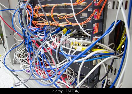 Bangkok Thailand :- Dec 10, 2019 :-  cable network in server room cable tangled of poorly routed cables Concept Organized Cabling in server rooms - Stock Photo