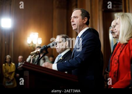 (Washington, USA. 10th Dec, 2019. -- U.S. House Intelligence Committee Chairman Adam Schiff (C, Front) speaks at a news conference to announce articles of impeachment against U.S. President Donald Trump on Capitol Hill in Washington, DC, the United States, on Dec. 10, 2019. U.S. House Democrats on Tuesday moved forward by announcing two articles of impeachment, accusing U.S. President Donald Trump of abuse of power and obstruction of Congress, culminating over two months of investigation by Democrat-led House committees into the president's dealings with Ukraine. (Photo by Ting S - Stock Photo