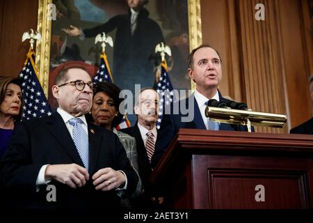 (Washington, USA. 10th Dec, 2019. -- U.S. House Intelligence Committee Chairman Adam Schiff (1st R) speaks at a news conference to announce articles of impeachment against U.S. President Donald Trump on Capitol Hill in Washington, DC, the United States, on Dec. 10, 2019. U.S. House Democrats on Tuesday moved forward by announcing two articles of impeachment, accusing U.S. President Donald Trump of abuse of power and obstruction of Congress, culminating over two months of investigation by Democrat-led House committees into the president's dealings with Ukraine. (Photo by Ting Shen - Stock Photo