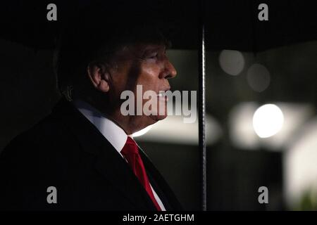 Washington, District of Columbia, USA. 10th Dec, 2019. United States President Donald J. Trump speaks to members of the media on the South Lawn of the White House in Washington, DC, U.S. as he departs for a Keep America Great Rally in Hershey, Pennsylvania on Tuesday, December 10, 2019. Credit: Stefani Reynolds/CNP/ZUMA Wire/Alamy Live News - Stock Photo