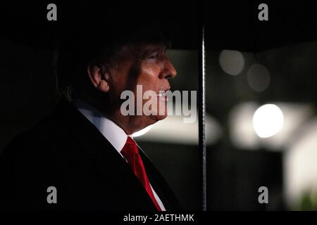 Washington, United States Of America. 10th Dec, 2019. United States President Donald J. Trump speaks to members of the media on the South Lawn of the White House in Washington, DC, U.S. as he departs for a Keep America Great Rally in Hershey, Pennsylvania on Tuesday, December 10, 2019. Credit: Stefani Reynolds/CNP | usage worldwide Credit: dpa/Alamy Live News - Stock Photo