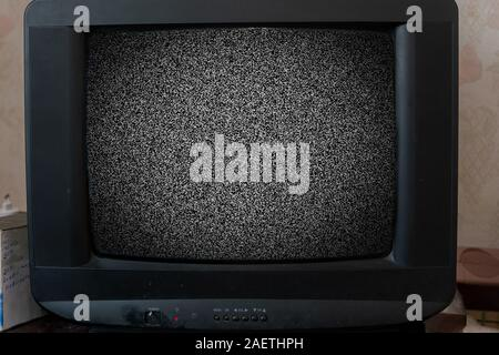 the old vintage tv with noise texture at home - Stock Photo