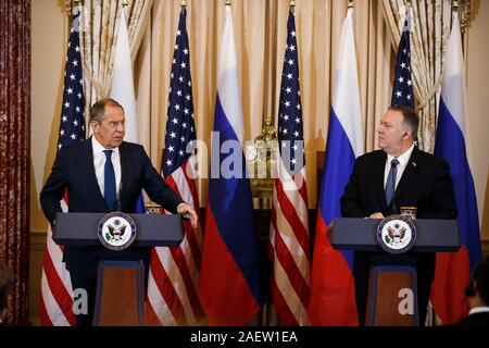 Washington, DC, USA. 10th Dec, 2019. U.S. Secretary of State Mike Pompeo (R) and Russian Foreign Minister Sergey Lavrov hold a joint press conference in Washington, DC Dec. 10, 2019. Credit: Ting Shen/Xinhua/Alamy Live News - Stock Photo