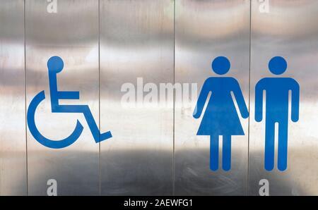 Symbols outside public toilet indicating disabled, women and men. - Stock Photo