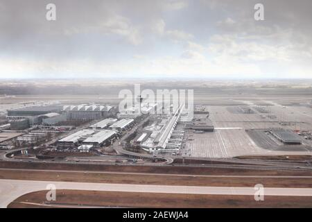 Aerial view of Munich Airport, the international airport of Munich, capital of Bavaria, Germany. View of the airport during a rain shower in spring. - Stock Photo