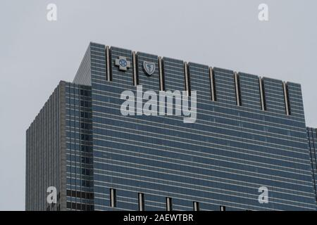 Chicago, USA - Circa 2019: Blue Cross Blue Shield commercial real estate building corporate headquarters downtown with emblem logos on top of building - Stock Photo