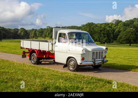 Dropside white Ford Custom van; Classic cars, historics, cherished, old timers, collectable restored vintage veteran, vehicles of yesteryear arriving for the Mark Woodward historical motoring event at Leighton Hall, Carnforth, UK - Stock Photo