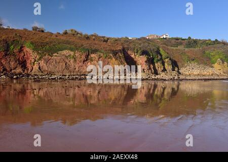 Reflections in Broadsands beach at low tide. - Stock Photo