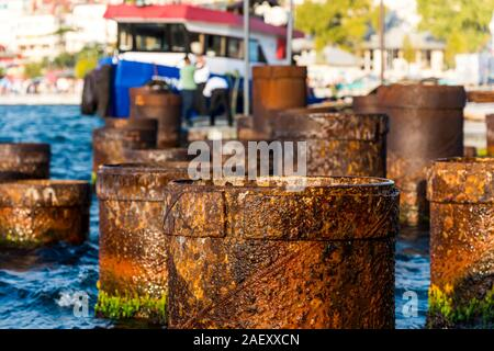 Rusty Steel Pipe berth for boats Coming From Out Of Sea at the Uskudar Istanbul, Turkey, on the Anatolian shore of the Bosphorus. - Stock Photo