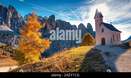Small church on the top of Gardena pass with Piz Boe mountain on background. Colorful autumn scene in the Dolomite Alps, Canazei, Province of Trento - Stock Photo