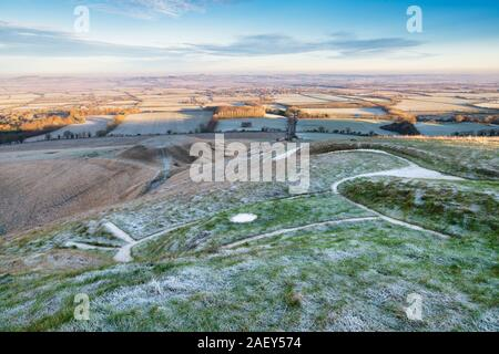 White horse hill and Dragon Hill in the early morning December frost at Uffington, viewed from While Horse Hill. Uffington, Oxfordshire, England - Stock Photo