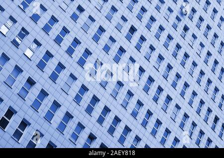 A pattern of many windows from a multi-storey office building. A large number of plastic windows in the wall of a modern multi-storey building. phanto - Stock Photo