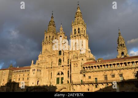 Cathedral with sunset light on a rainy day. View from Praza do Obradoiro. Santiago de Compostela, Spain.