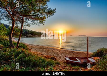 The sunrise at the beach Chrisi Milia of Alonissos island, Greece - Stock Photo