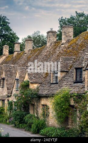 Cottages on Arlington Row in Bibury, Gloucestershire in the Cotswolds, England, UK - Stock Photo