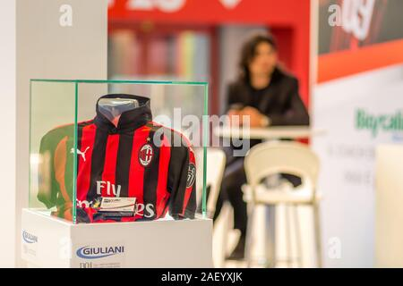 BOLOGNA (BO), ITALY - APRIL 12, 2019: light is enlightening AC Milan suit in Cosmofarma Exhibition, the pharmacy world's leading European event for th - Stock Photo