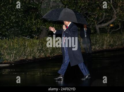 Washington, District of Columbia, USA. 10th Dec, 2019. United States President DONALD TRUMP waves to the press as he returns to the White House in Washington, DC from Pennsylvania where he spoke at two campaign rallies on Tuesday. Credit: Ron Sachs/CNP/ZUMA Wire/Alamy Live News - Stock Photo