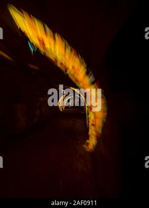 Underground tunnel under Rijeka in Croatia lighted illuminated for festivity - Stock Photo