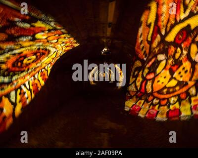 Underground tunnel under Rijeka in Croatia lighted illuminated for festivity - Stock Photo