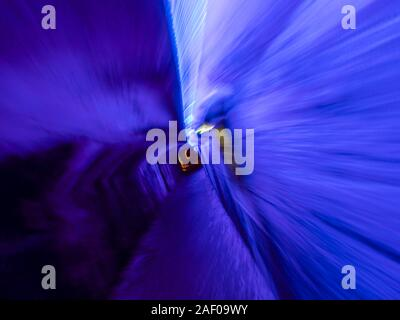 Underground tunnel under Rijeka in Croatia lighted illuminated for festivity Blue color - Stock Photo