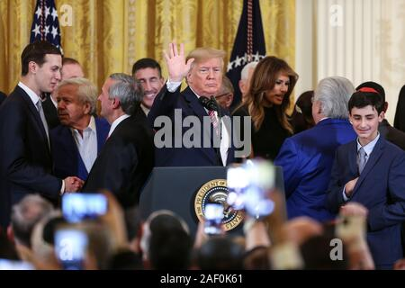 Washington, USA. 11th Dec, 2019. President Donald Trump gestures after he delivered remarks during a Hanukkah Reception on December 11, 2019 in Washington, DC. (Photo by Oliver Contreras/SIPA USA) Credit: Sipa USA/Alamy Live News - Stock Photo