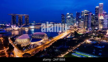 Singapore's downtown skyline, business district and harbor area, with buildings and streets illuminated. Photo taken from 35th floor. - Stock Photo