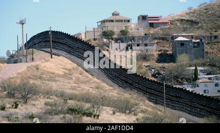 Nogales, United States. 12th Dec, 2019. Barbed wire has been placed on top and side of the fence along the United States-Mexico border, shown here, heading East from Nogales, Arizona, on February 8, 2019. The Arizona city has ordered Federal Officials to remove the barbed wire. Photo by Art Foxall/UPI Credit: UPI/Alamy Live News - Stock Photo