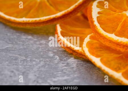 Closeup Of Dried Orange Slices On Stone Substrate - Stock Photo