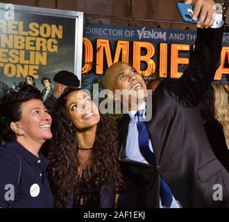 Los Angeles, United States. 12th Dec, 2019. Cast member Rosario Dawson (C) and U.S. Senator and Democratic presidential candidate Cory Booker (D-NJ) take a selfie with a guest during the premiere of the motion picture horror-comedy 'Zombieland: Double Tap' at the Regency Village Theatre in the Westwood section of Los Angeles on Thursday, October 10, 2019. Photo by Jim Ruymen/UPI Credit: UPI/Alamy Live News