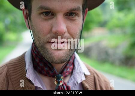 Bento Goncalves, Rio Grande do Sul, Brazil - October 15, 2015: Young Gaucho in traditional clothing in a road in the countryside of Bento Goncalves - Stock Photo