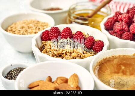 Oatmeal porridge with raspberry and figs in bowl - Stock Photo