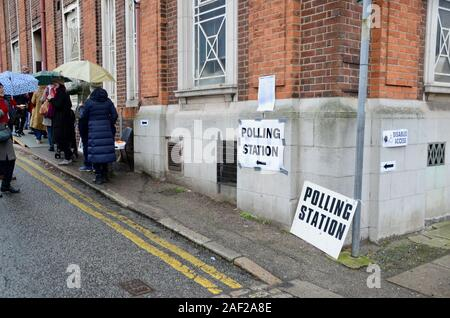 queues to vote in the rain at muswell hill polling station haringey london UK - Stock Photo
