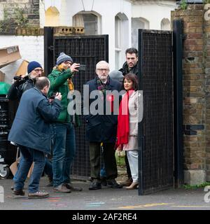 London, UK. 12th Dec, 2019. Jeremy Corbyn and his wife Laura Alvarez at polling station during the General Elections. London, UK.  Credit: dpa picture alliance/Alamy Live News - Stock Photo