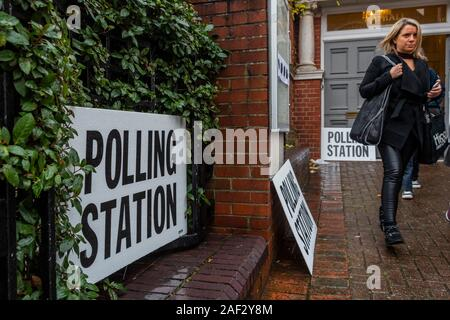 Wandsworth, London, UK. 12th Dec, 2019. Balham Library - Despite the grim weather people seem determined to vote in the General Election. There is a steady flow of people into and out of the polling stations in Wandsworth. Credit: Guy Bell/Alamy Live News - Stock Photo