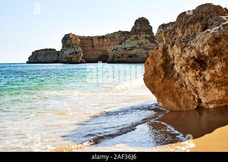 Rocks and sandy beach in Portugal, Atlantic coast. - Stock Photo