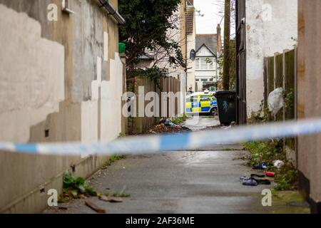 Westcliff on Sea, UK. 12th Dec, 2019. Forensic and Police officers officer's on the scene at a murder investigation. Essex Police were called at approximately  4.30am this morning to reports of a disturbance at an address in Tintern Avenue, Westcliff. Nearby alley ways are sealed off, and forensic officers searching a house in the road. Penelope Barritt/Alamy Live news. - Stock Photo