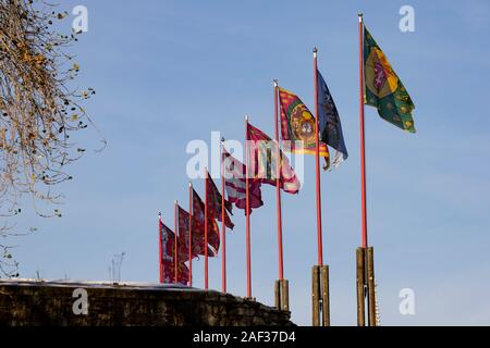 Heraldic flags flying at Buda Castle, Winter in Budapest, Hungary. December 2019 - Stock Photo