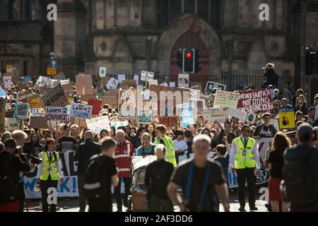 Scottish youths strike for the climate, during a global day of action, taking the day off school and educational establishments to protest the Government's inaction on the climate crisis, in Edinburgh, Scotland, 20th September 2019. The youths made their way from the Meadows area of the city, down the historic Royal Mile to the Scottish Parliament. - Stock Photo