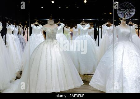 A lot of beautiful wedding dresses on display - Stock Photo