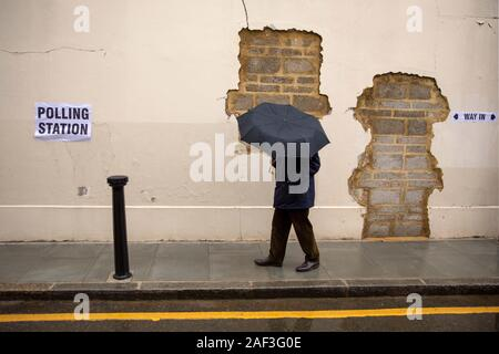 London, UK. 12th Dec, 2019. A man passes by a polling station for the general election in London, Britain on Dec. 12, 2019. Millions of voters on Thursday flocked to cast their ballots in Britain's third election in less than five years as polling stations opened across the country at 7:00 a.m. (0700 GMT). Credit: Tim Ireland/Xinhua/Alamy Live News - Stock Photo