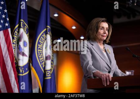 Washington, DC, USA. 12th Dec, 2019. Speaker of the United States House of Representatives Nancy Pelosi (Democrat of California) speaks at her weekly press conference on Capitol Hill in Washington, DC, U.S., on Thursday, December 12, 2019. | usage worldwide Credit: dpa/Alamy Live News - Stock Photo