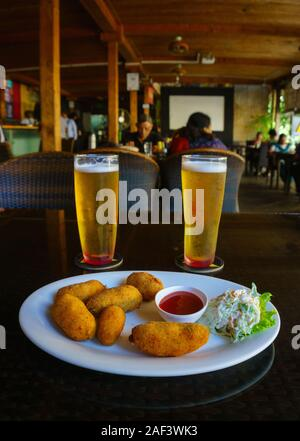 Chilled beer and fried cheese balls served in a restaurant locate in Church Street, Bangalore (India) - Stock Photo